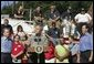 President George W. Bush discusses the recovery efforts at the Millvale, Pa. Fire Department in Western Pennsylvania during a visit to the area recently flooded by Tropical Depression Ivan in Allegheny County, Wednesday, Sept. 22, 2004. White House photo by Eric Draper.