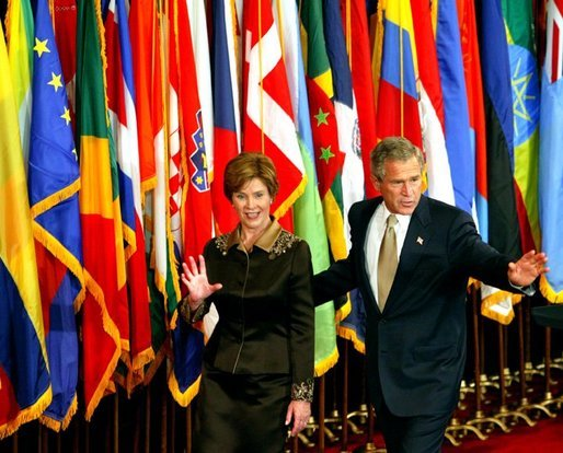 President George W. Bush and Laura Bush wave to their guests at the United States Reception at theWaldorf Astoria Hotel in New York City, Tuesday, Sept. 22, 2002. White House photo by Tina Hager.