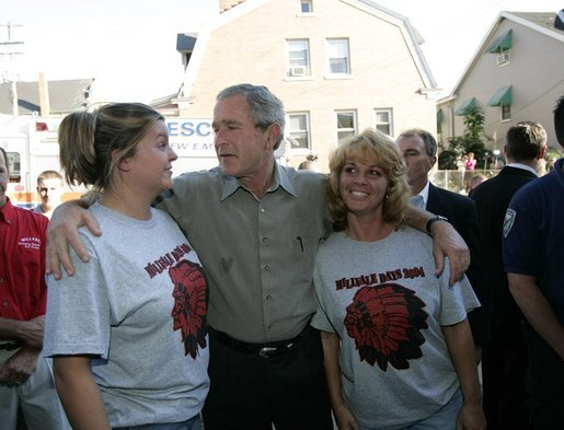 President George W. Bush talks with residents of Millvale, Pa. at the Millvale Fire Department during a visit to the area recently flooded by Tropical Depression Ivan in Allegheny County, Pa., Wednesday, Sept. 22, 2004. White House photo by Eric Draper.