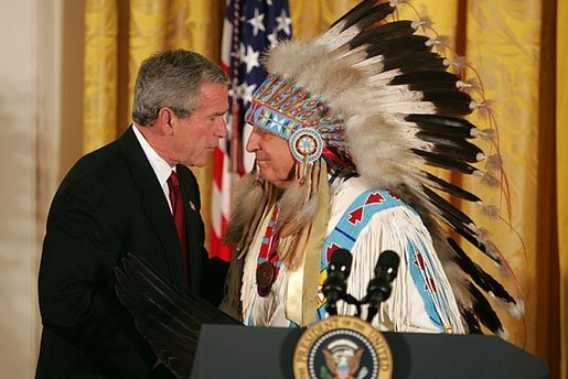 President George W. Bush greets Sen. Benjamin Nighthorse Campbell, R-Colo., during a ceremony marking the opening of the National Museum of the American Indian in the East Room Thursday, Sept. 23, 2004. White House photo by Paul Morse