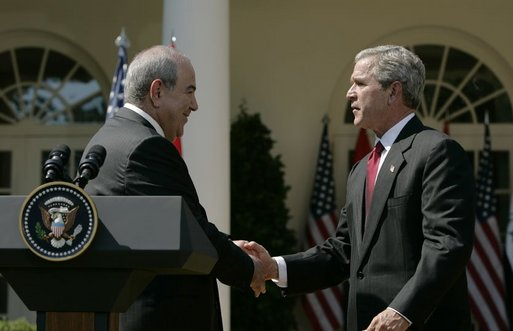 President George W. Bush shakes hands with Iraqi interim Prime Minister Ayad Allawi after their joint press conference in the Rose Garden Thursday, Sept. 23, 2004. White House photo by Paul Morse