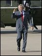 President George W. Bush salutes as he departs Waco, Texas, Monday, Sept. 27, 2004. White House photo by Eric Draper.