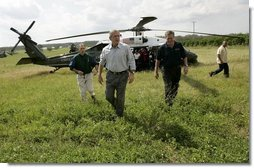 President George W. Bush and Governor Jeb Bush, right, arrive at Marty and Pat McKenna's orange grove to tour damage by the recent hurricanes in Lake Wales, Fla., Wednesday, Sept. 29, 2004.  White House photo by Eric Draper