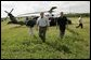 President George W. Bush and Governor Jeb Bush, right, arrive at Marty and Pat McKenna's orange grove to tour damage by the recent hurricanes in Lake Wales, Fla., Wednesday, Sept. 29, 2004. White House photo by Eric Draper.