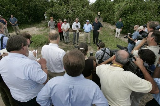 After touring the hurricane damage to Marty and Pat McKenna's orange groves, President George W. Bush addresses the media at the their farm in Lake Wales, Fla., Sept. 29, 2004. White House photo by Eric Draper.