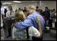 "President George W. Bush shares a hug during a visit to Martin County Red Cross Headquarters in Stuart, Fla., Thursday, Sept. 30, 2004. ""People in Florida and many other states are coming through a trying time,"" said the President in an address to the press. ""I thank all those who've reached out to help the neighbors in need."" White House photo by Eric Draper"