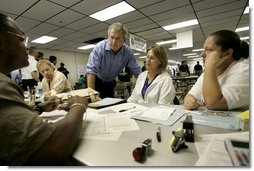 "President George W. Bush visits with hurricane relief workers at Martin County Red Cross Headquarters in Stuart, Fla., Thursday, Sept. 30, 2004. ""See, these volunteers show the true heart of America, because we're a compassionate people, we care when a neighbor hurts, we long to help somebody when help is needed,"" said the President. ""They have the gratitude of all they've served, and they have the admiration for our whole country.""  White House photo by Eric Draper"