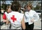 Laura Bush speaks with American Red Cross Disaster Relief workers outside of the Vero Beach Community Center where disaster relief family services are offered to local residents in Vero Beach, Fla., Friday, Oct. 1, 2004. Vero Beach, Fla., was one of the areas hardest hit by Hurricanes Jeanne and Frances. White House photo by Joyce Naltchayan.