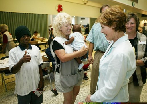 Laura Bush visits with local residents and volunteer workers at the Red Cross Disaster Relief Family Services. located at the Vero Beach Community Center in Vero Beach, Fla., Friday, Oct. 1, 2004. The City of Vero Beach was one of the areas hardest hit by Hurricanes Jeanne and Frances. White House photo by Joyce Naltchayan.