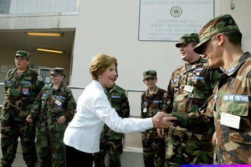 Laura Bush is greeted by members of the National Guard outside the Emergency Operations Center in Vero Beach, Fla., Friday, Oct. 1, 2004. White House photo by Joyce Naltchayan.