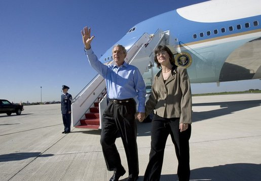 President George W. Bush walks away from Air Force One with USA Freedom Corps Greeter Cheryl Hornung at Lehigh Valley International Airport in Allentown, Pa., Friday, Oct. 1, 2004. Hornung founded Caitlin's Smiles in March of 2004, which provides toys to children with life-threatening illnesses while they are awaiting medical procedures. The program was inspired by Hornung's daughter, Caitlin, who lost her battle with cancer four years ago. White House photo by Eric Draper.