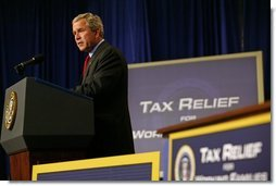 President George W. Bush speaks during the signing of H.R. 1308, the Working Families Tax Relief Act of 2004, at the South Suburban YMCA in Des Moines Iowa, Monday, Oct. 4, 2004.  White House photo by Tina Hager