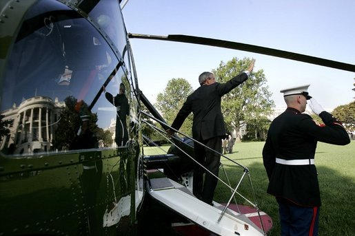 President George W. Bush waves from the steps of Marine One before departing the South Lawn Monday morning, Oct. 4, 2004. The President left for Des Moines, Iowa, to sign H.R. 1308, the Working Families Tax Relief Act of 2004. White House photo by Eric Draper