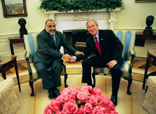 President George W. Bush speaks with Adil Abd al-Mahdi, Finance Minister of the Interim Government of the Republic of Iraq, Thursday, October 07, 2004, in the Oval Office. White House photo by Eric Draper