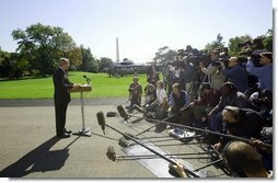 President George W. Bush discusses the Iraq report with the press on the South Lawn Thursday, Oct. 7, 2004.  White House photo by Eric Draper