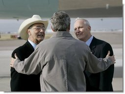 President George W. Bush talks with USA Freedom Corps Greeters Bob Carlone, left, and Joe Henjum at Peterson Air Force Base in Colorado Springs, Colo., Tuesday, Oct. 12, 2004. In May 2003, Mr. Carlene and Mr. Henjum created The Home Front Cares program to provide support for military families in the Pikes Peak region whose loved ones are deployed.  White House photo by Eric Draper