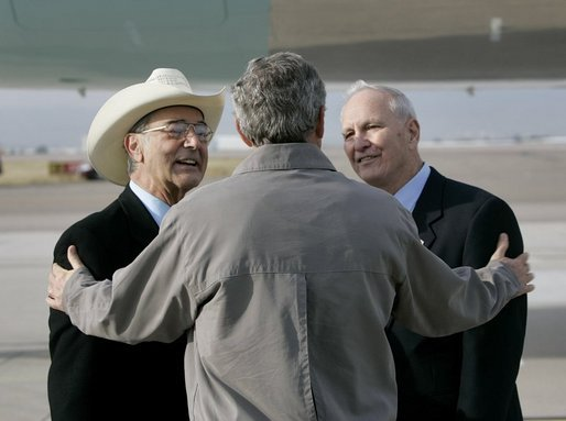 President George W. Bush talks with USA Freedom Corps Greeters Bob Carlone, left, and Joe Henjum at Peterson Air Force Base in Colorado Springs, Colo., Tuesday, Oct. 12, 2004. In May 2003, Mr. Carlene and Mr. Henjum created The Home Front Cares program to provide support for military families in the Pikes Peak region whose loved ones are deployed. White House photo by Eric Draper.