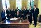 President George W. Bush signs HR 5467, The Department of Homeland Security Appropriations Act for the Fiscal Year 2005, in the Oval Office Monday, Oct. 18, 2004. White House photo by Tina Hager