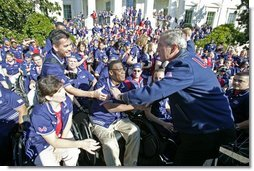After addressing the athletes, President George W. Bush greets members of the 2004 U.S. Olympic and Paralympic Teams on the South Lawn Monday, Oct. 18, 2004.  White House photo by Tina Hager
