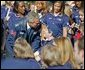 Wearing an Olympic jacket, President George W. Bush greets members of the 2004 U.S. Olympic and Paralympic Teams on the South Lawn Monday, Oct. 18, 2004. White House photo by Tina Hager