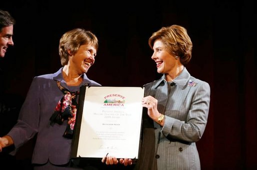 "Laura Bush presents Kathleen ""Kathy"" Keen with a certificate honoring her as the national Preserve America History Teacher of the Year at the New York Historical Society in New York, Oct. 19, 2004. White House photo by Joyce Naltchayan"