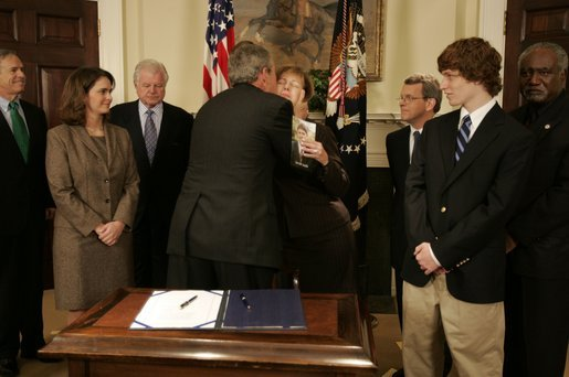 President George W. Bush hugs Sharon Smith, mother of Garret Smith, who committed suicide last year, during the signing ceremony of S. 2634, the Garrett Lee Smith Memorial Act, in the Roosevelt Room Thursday, Oct. 21, 2004. The act authorizes the spending of $82 million for youth suicide prevention programs at college campus mental health centers. Mrs. Smith is married to Sen. Gordon Smith, R-Ore. White House photo by Paul Morse