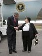 President George W. Bush talks with USA Freedom Corps Greeter Dolly Yunkunis in front of Air Force One in Wilkes-Barre, Pennsylvania, Friday, Oct. 22, 2004. White House photo by Eric Draper.