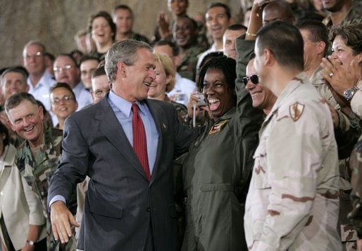 After delivering his remarks, President Bush greets military personnel at MacDill Air Force Base in Tampa, Fla., June 16, 2004. White House photo by Eric Draper.