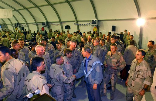 To show his support for America's troops, President Bush makes a surprise visit to Iraq and shares Thanksgiving Dinner with U.S. troops at the Bob Hope Dining Facility, Baghdad, Iraq, Nov. 27, 2003. White House photo by Tina Hager.