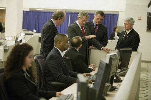 President George W. Bush tours the National Targeting Center (NTC) in Reston, Va., Feb. 6, 2004. The NTC is part of Homeland Security's Bureau of Customs and Border Protection, the center provides analytical research support for counterterrorism efforts. White House photo by Paul Morse