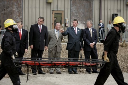 President George W. Bush observes a demonstration by first responders at Northeastern Illinois Public Training Academy in Glenview, Illinois, July 22, 2004. White House photo by Paul Morse