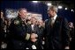 President George W. Bush greets firemen after remarks on homeland security at Northeastern Illinois Public Training Academy in Glenview, Illinois on Thursday July 22, 2004. White House photo by Paul Morse