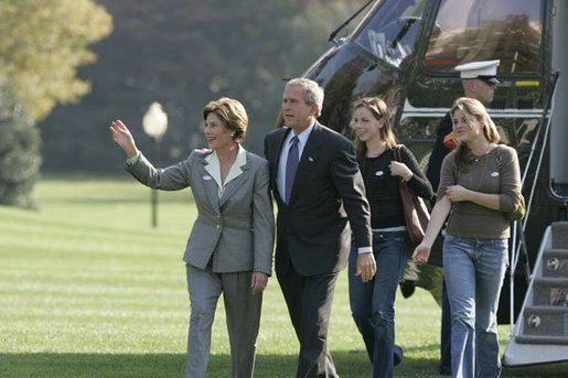 President George W. Bush and Laura Bush return to the White House with their daughters Barbara, left, and Jenna, right, Tuesday, Nov. 2, 2004. White House photo by Paul Morse