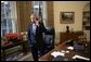 Standing at his desk in the Oval Office, President George W. Bush receives a phone call from Democratic presidential candidate John Kerry in which the senator conceded defeat in the 2004 presidential election Wednesday, Nov. 3, 2004.  White House photo by Eric Draper
