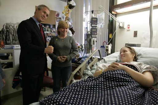 President George W. Bush greets U.S. Army Sgt. Carla Best of Virginia Beach, Va., and her mother Vickie Ebeling during a visit to Walter Reed Army Medical Center in Washington, D.C., Tuesday, Nov. 9, 2004. Sgt. Best sustained injuries while serving in Operation Iraqi Freedom. White House photo by Eric Draper.