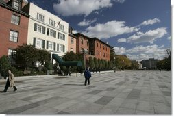 Pedestrians stroll across Pennsylvania Avenue in front of the Blair House after a brief ceremony by Laura Bush, in which she opened Pennsylvania Avenue's walkways as a permanent pedestrian park Tuesday, Nov. 9. 2004.  White House photo by Paul Morse