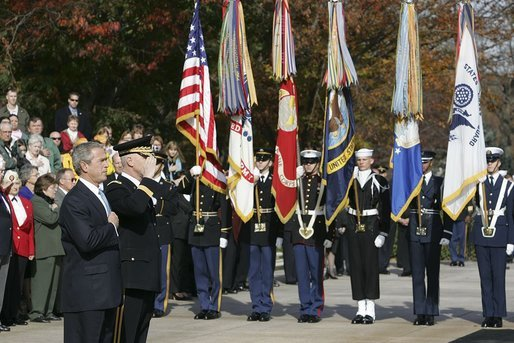 "President George W. Bush salutes the playing of the national anthem during a wreath laying ceremony at the Tomb of the Unknowns on Veterans Day Thursday, Nov. 11, 2004. ""Today we also recall the men and women who did not live to be called ""veterans,"" many of whom rest in these hills. Our veterans remember the faces and voices of fallen comrades. The families of the lost carry a burden of grief that time will lighten, but never lift,"" said the President in his remarks. White House photo by Paul Morse"