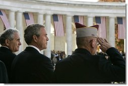 "President George W. Bush stands with Secretary of Veterans Affairs Anthony Principi, left, and Mr. Gene Overstreet, President of the Non-Commissioned Officers Association, during the Veterans Day ceremonies at Arlington National Cemetery Nov. 11, 2004. ""We honor every soldier, sailor, airman, Marine and Coastguardsman who gave some of the best years of their lives to the service of the United States and stood ready to give life, itself, on our behalf,"" said the President in his remarks. White House photo by Paul Morse"