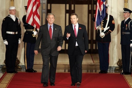 President George W. Bush and British Prime Minister Tony Blair walk down the Cross Hall of the White House before their press conference on Friday November 12, 2004. White House photo by Paul Morse