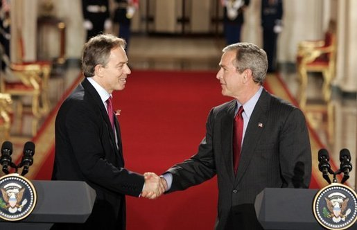 President George W. Bush and British Prime Minister Tony Blair shake hands after their press conference in the East Room of the White House on Friday November 12, 2004. White House photo by Paul Morse
