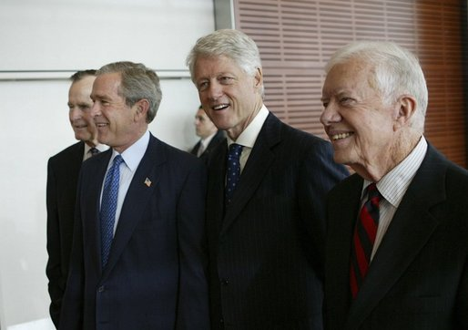 President George W. Bush, walks with, from left, former President George H.W. Bush, former President Bill Clinton, and former President Jimmy Carter during the dedication of the William J. Clinton Presidential Center and Park in Little Rock, Ark., Nov. 18, 2004. White House photo by Eric Draper.