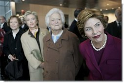 Laura Bush and former first ladies, from left, Rosalynn Carter, Sen. Hillary Clinton, and Barbara Bush attend the dedication ceremony for the William J. Clinton Presidential Center and Park in Little Rock, Ark., Nov. 18, 2004.  White House photo by Eric Draper