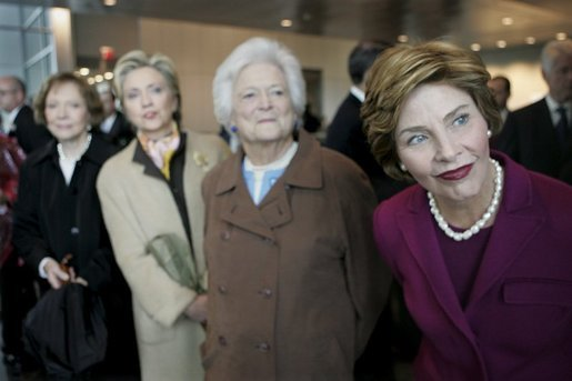 Laura Bush and former first ladies, from left, Rosalynn Carter, Sen. Hillary Clinton, and Barbara Bush attend the dedication ceremony for the William J. Clinton Presidential Center and Park in Little Rock, Ark., Nov. 18, 2004. White House photo by Eric Draper.