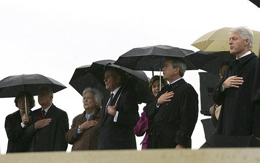 President George W. Bush and Laura Bush stand at attention with, from left, former President Jimmy Carter and First Lady Rosalynn Carter; former President George H.W. Bush and First Lady Barbara Bush; and former President Bill Clinton, Chelsea Clinton, and Sen. Hillary Clinton (not pictured) during the dedication ceremony of the William J. Clinton Presidential Center and Park in Little Rock, Ark., Nov. 18, 2004. White House photo by Eric Draper.