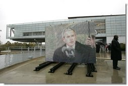 "As pictured on an outdoor video screen, President George W. Bush addresses attendees during the dedication of former President Bill Clinton's Presidential Center and Park in Little Rock, Ark., Nov. 18, 2004. ""He was a tireless champion of peace in the Middle East. He used American power in the Balkans to confront aggression and halt ethnic cleansing. And in all his actions and decisions, the American people sensed a deep empathy for the poor and the powerless,"" said President Bush.  White House photo by Eric Draper"