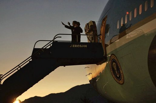 Standing outside Air Force One, President George W. Bush and Laura Bush wave upon their arrival in Santiago, Chile, for an APEC summit Nov. 19, 2004. White House photo by Paul Morse