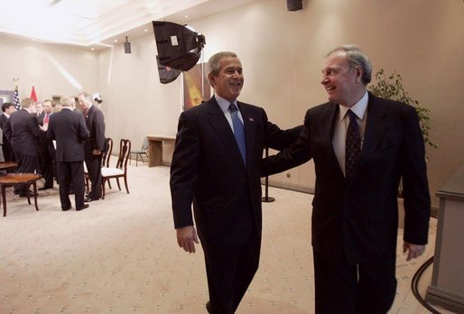 President George W. Bush and Canadian Prime Minister Paul Martin share a light moment after a bilateral meeting in Santiago, Chile, Nov. 20, 2004. President Bush and Prime Minister Martin are joined in Chile by the leaders of 19 other countries attending this year's APEC summit. White House photo by Eric Draper.