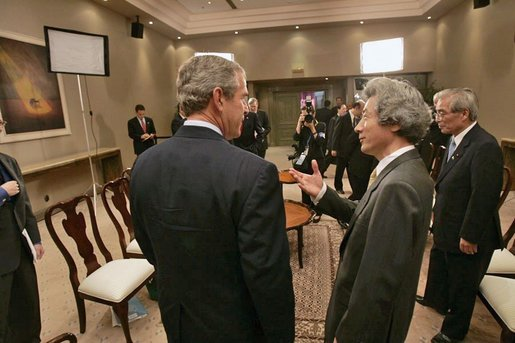 President George W. Bush participates in a morning meeting with Japanese Prime Minister Junichiro Koizumi while attending an APEC summit in Santiago, Chile, Nov. 20, 2004. White House photo by Eric Draper