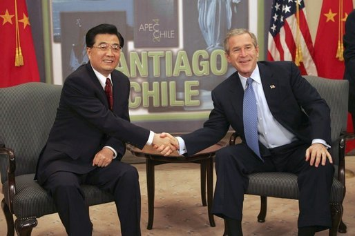 President George W. Bush and President Jintao Hu of China meet while attending an APEC summit in Santiago, Chile, Nov. 20, 2004. White House photo by Eric Draper.