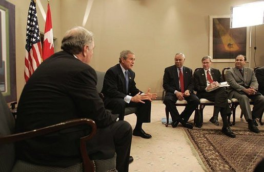 While attending an APEC summit, President George W. Bush participates in a bilateral meeting with Canadian Prime Minister Paul Martin in Santiago, Chile, Nov. 20, 2004. White House photo by Eric Draper